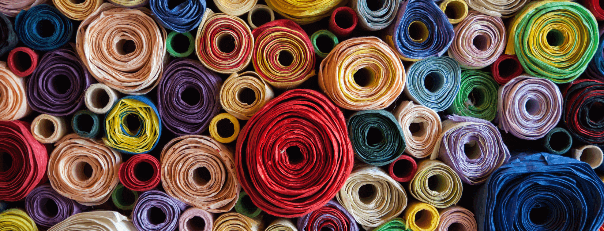 Carefully organized colorful rolls of textile