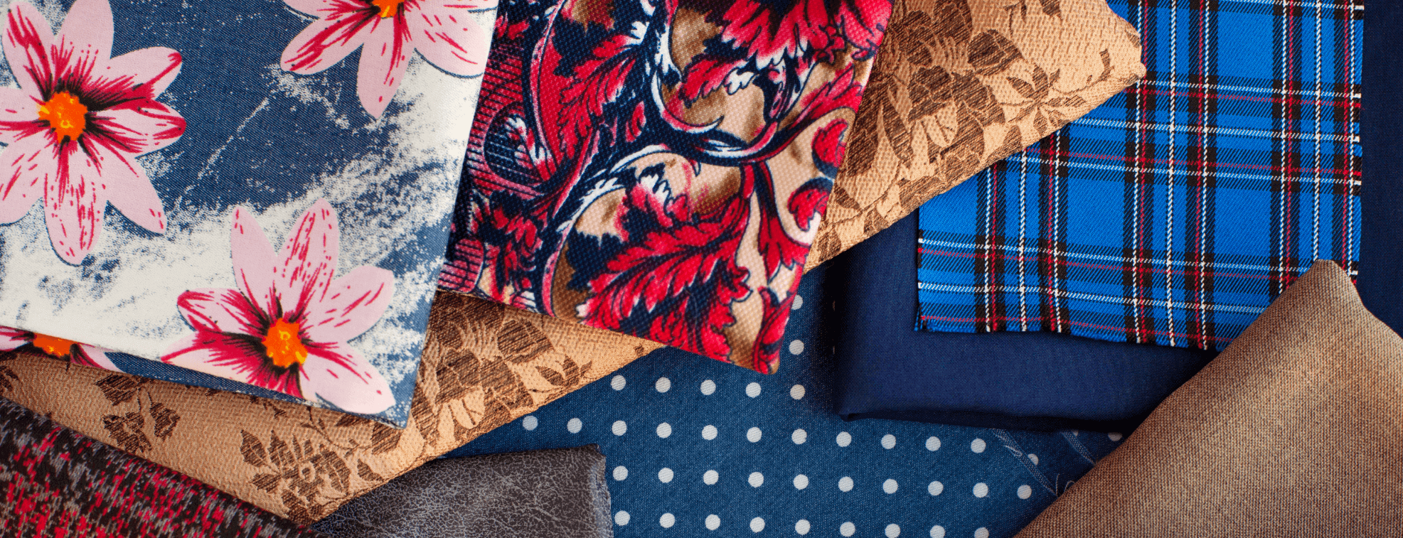 Different colorful textiles with prints placed on a table